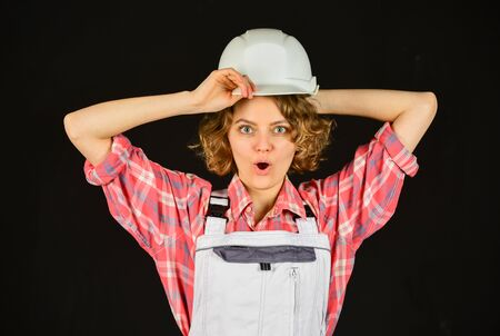 Warehouse woman worker. Woman builder in hardhat. Girl engineer or architect. Home renovation. Quality inspector. Construction job occupation. Construction worker. Lady at construction site