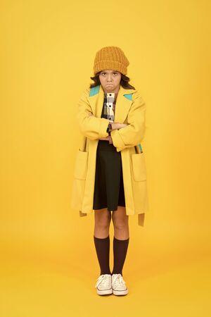 Street style. Rebel teen girl. Madcap concept. Teen age. Girl adorable stylish modern teenager. Cool schoolgirl. Have fun charismatic girl on yellow background. Teen spirit. Rebellious teen 版權商用圖片