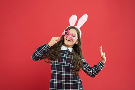 Party time. Cheer up. Little cute bunny. Having fun. Schoolgirl bunny ears. Girl in Easter bunny at egg hunt. Party and social event. Family holiday. Traditional party activities. Booth props 版權商用圖片