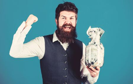 Financial success. Businessman with his dollar savings. Richness and wellbeing. Security and cash money savings. Banking concept. General savings tips. Man bearded hipster hold jar full of cash 스톡 콘텐츠