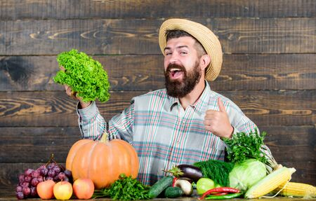Farm market harvest festival. Man bearded farmer with vegetables rustic style background. Sell vegetables. Local market. Locally grown crops concept. Homegrown vegetables. Buy vegetables local farm
