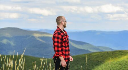 successful. travelling adventure. hipster fashion. man on mountain landscape. camping and hiking. cowboy in hat outdoor. countryside concept. farmer on rancho. macho man in checkered shirt