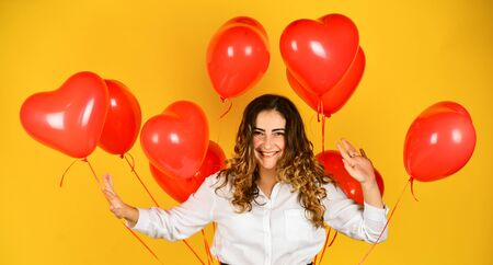 I give you my heart. helium balloon for party. happy valentines day. girl got heart balloon from valentine. love and joy. woman air balloon gift. february 14 favorite holiday. surprise with love