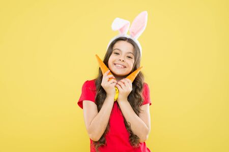 nutrition diet for health. benefit of eateing carrot. easter carrot recipes. stay healthy and happy. small girl hold carrot. child in bunny ears. I always make a healthy choice