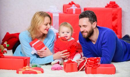 Together on valentines day. Lovely family celebrating valentines day. Happy parents. Life can not be better. Family celebrate anniversary. Couple in love and baby daughter. Valentines day concept Foto de archivo