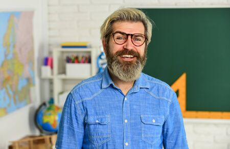 Inspiring to learn. Modern school. Private lesson. School projects. Back to school. Mature bearded man in glasses. Education concept. Intellectual task. Cognitive development. Teacher work at college