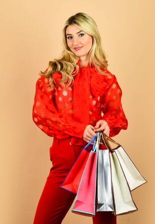 woman prepare for holidays. savings on purchases. sexy lady with bags. perfect purchase. after successful shopping. clearance sale concept. sale and discount. girl online shopping. Heavy bags Stock Photo