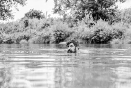 Submerge into water. Freshness of wild nature. Summer vacation. Deep dangerous water. Relaxation and rest. Swimming sport. Swimming skills. Refreshing feeling. Man enjoy swimming in river or lake