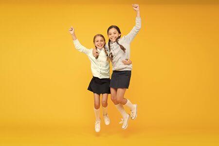 Kids cute students. Schoolgirls best friends excellent pupils. Schoolgirls tidy appearance school uniform. School friendship. September again. Childhood happiness. School day fun cheerful moments Stockfoto