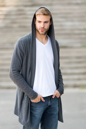 man in hoody. man in hood outdoor. hooligan wear hoodie. looking like thief in hooded cardigan. Casual style. concept of danger and confidence. Urban fashion look. city modern life Banque d'images