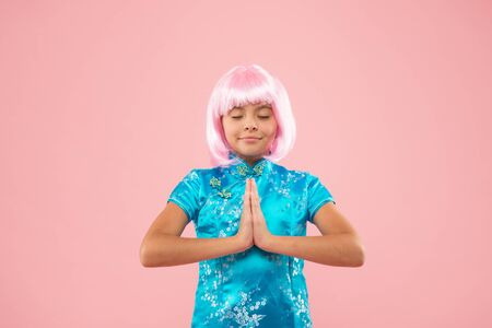 Without a sound. Happy child do meditation holding hands in namaste. Meditation or prayer. Small girl enjoy meditation practice. Meditation and concentration. Zen and enlightenment. buddhist