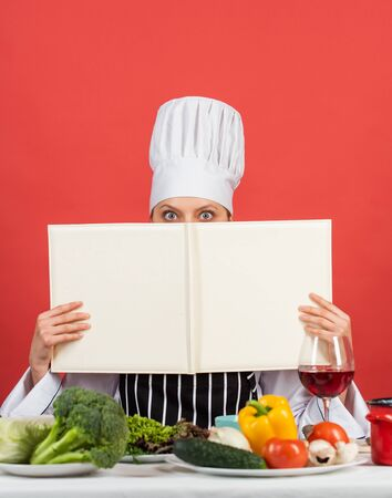 you are what you eat. woman chef read cookbook. Can be used for cooking. Food studio in restaurant. Chef preparing recipe. Recipe book. The best recipe. cooking concept. Working in a Modern Kitchen. 版權商用圖片