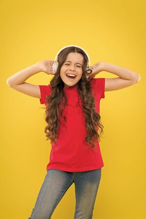 Kid listening music headphones. Music beat concept. Entertainment and fun. Top summer songs. Child or teen enjoy music playing in earphones. Little girl enjoying her favorite music. Catch the rhythm