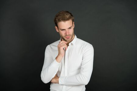 Mens personal care. Serious man dark background. Handsome guy with unshaven face. Skin care routine. Skincare. Haircare. Barbershop. Hair salon. Mens grooming and care. Care and health