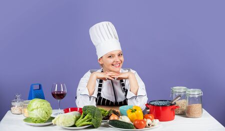 Slim is healthy. healthy food and diet. woman housewife in cook hat and apron. fresh raw preparing. full of vitamin. natural and organic. restaurant kitchen lifestyle. happy chef cooking vegetables