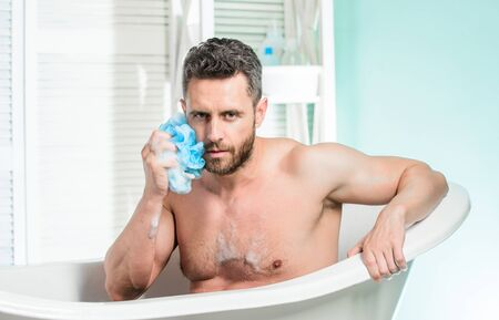 Personal hygiene. Take care hygiene. Personal grooming is cleaning parts body. Hygiene concept. Bath have greater effect mood than physical exercise. Man bearded hipster use sponge cleaning skin Archivio Fotografico