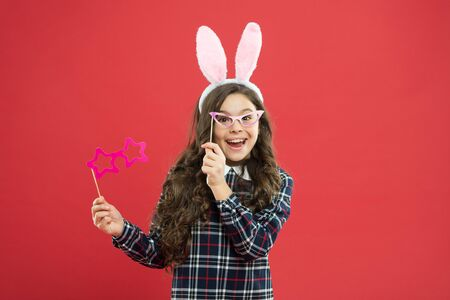 Nerd party. Traditional party activities. Booth props. Cheer up. Little cute bunny. Having fun. Schoolgirl bunny ears. Girl in Easter bunny at egg hunt. Party and social event. Family holiday