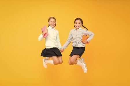 Childhood happiness. Schoolgirls tidy appearance school uniform. School friendship. September again. School day fun cheerful moments. Kids cute students. Schoolgirls best friends excellent pupils