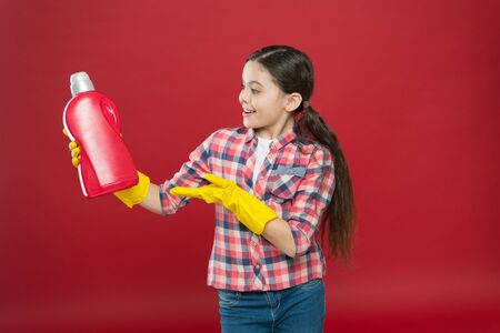 Cleaning supplies. Disinfecting gels suitable for all family. Girl in rubber gloves for cleaning hold plastic bottle chemical liquid. Help clean up. Use product for cleaning. Housekeeping concept Imagens