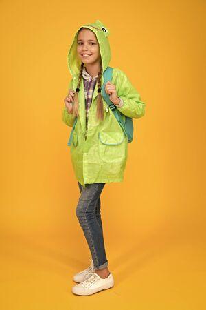 Waterproof cloak. Waterproof fabric for your comfort. Rainproof accessory. Schoolgirl hooded raincoat enjoy rainy weather. Waterproof clothes every kid should try. Kid girl happy wear raincoat