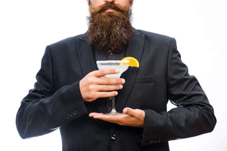 Hipster prepared cocktail. Man holds glass, delicious cocktail with orange,