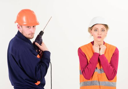 Woman with scared face in helmet, hard hat.