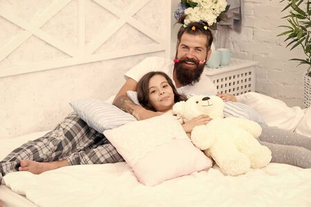 Family traditions. good night. funny pajama party. small girl with bearded father in bed. weekend at home. father and daughter having fun. family bonding time. i love my daddy. happy morning together