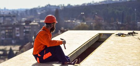 Heat insulation. Professional master repair roof. Flat roof installation. Roofer constructing new roof. Man roofing surface. Estimate materials requirements for projects. Install roofing materials
