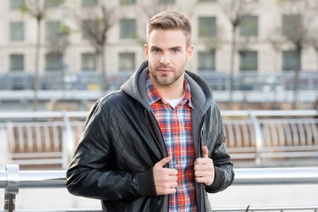 Handsome look. Handsome man on urban outdoors. Caucasian guy with unshaven handsome face and stylish hair. Style and grooming. Mens fashion trends. Urban lifestyle. Confident and handsome