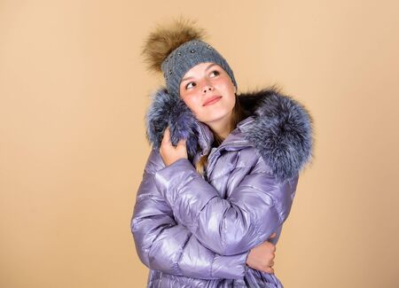 Warming up. Casual winter jacket slightly more stylish and have more comfort features such as larger hood fur trim on hood. Fashion girl winter clothes. Fashion coat and hat. Fashion trend. Faux fur Stock fotó