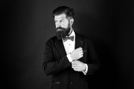 Neat and tidy. Stylist fashion expert. Suit style. Fashion trends for groom. Groom bearded hipster man wear tuxedo and blue bow tie. Wedding day concept. Stylish groom. Elegant collection