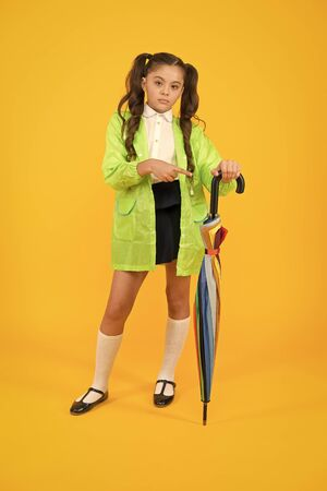 Autumn rain. Going to school. Rainproof clothes. Rain is finished. Fall rain. Waiting for rainy days. Schoolgirl stylish little kid with umbrella wear waterproof raincoat. Water resistant clothes