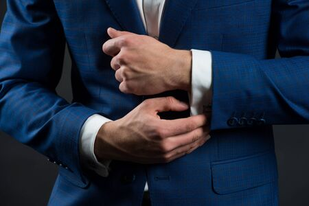Perfect to last detail. Getting dressed. Formal suit shirt and cuffs. Wearing formal style. Fashion and style. Formal clothes. Dress code. Wedding ceremony. Holiday celebration. Formal and classy