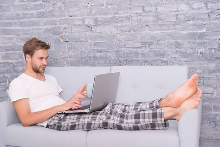Online Education. handsome man communicate on laptop. use notebook before sleep. male blogger use internet technology. networking on computer. freelance work from home. distance job while quarantine