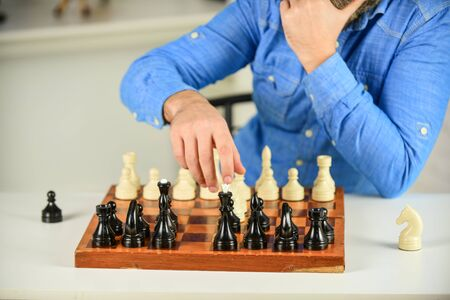 Playing chess. Intellectual hobby. Figures on wooden chess board. Thinking about next step. Tactics is knowing what to do. Development logics. Learning play chess. Chess lesson. Strategy concept.