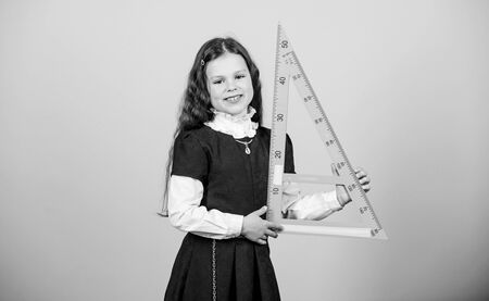 Smart and clever concept. Girl with big ruler. School student study geometry. Sizing and measuring. Kid school uniform hold ruler. School education concept. Learn mathematics. Theorems and axioms