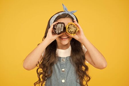 funny retro girl muffin yellow background. happy child love desserts. Yummy cupcakes. happy birthday cake. candy shop. Bakery and confectionery concept. Sweet tooth concept. Cafe restaurant food