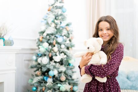 Cute little child girl with xmas present. The morning before Xmas. waiting for santa. Winter. happy new year. Christmas shopping. christmas family holiday. By golly, be jolly