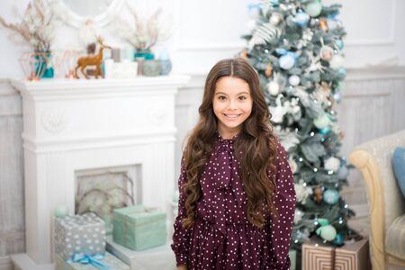The morning before Xmas. New year holiday. Happy new year. small happy girl at christmas. Christmas. Kid enjoy the holiday. little child girl likes xmas present. Happy New 2019 Year