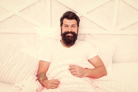 Circadian rhythm is natural internal process that regulates sleep wake cycle. Perfect rest. Man handsome guy in bed. Enough amount sleep every night. Tips sleep better. Bearded man relaxing on pillow