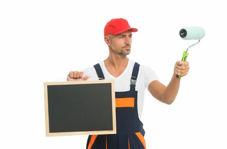Learn new skills and develop your career. Decorator hold school blackboard and paint roller. Painter training school. Vocational and technical school. Welcome to school of painting, copy space