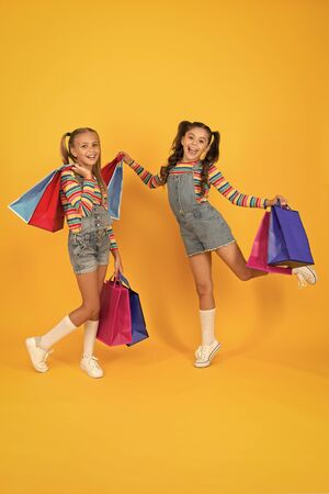 Summer shopping. Buyer consumer concept. Total sale. Kids fashion. Holiday purchase saving. Home shopping. Small girls with shopping bags. Sales and discounts. Happy children. Little girls with gifts