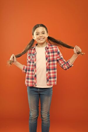 Grow long hair. Hairstyle for kids. Small child long hair. Girl kid with long gorgeous hair. Strong and healthy hair concept. Nice hairstyle. Natural beauty. Shampoo and conditioner. Shine and length