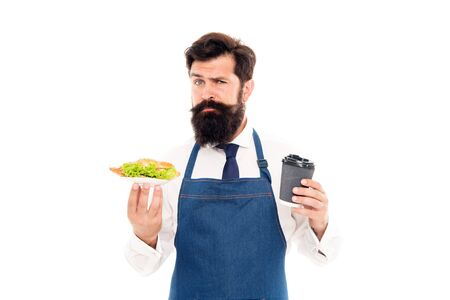 Cafe food concept. Man bearded waiter wear apron carry plate with food and coffee cup. Delicious croissant. Enjoy your meal. Guy serving croissant stuffed lettuce and fresh vegetables. Healthy food Archivio Fotografico