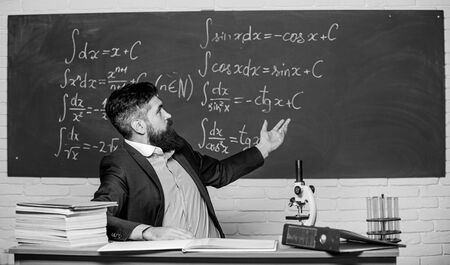 Teaching and education. University teacher use teaching aids. Bearded man teaching chemistry in school. Pedagogical techniques and teaching methods