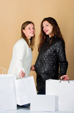 Women friends shopping winter accessories. Shopping guide. Sale and discount. Shopping bags. Having fun together. Black friday. Buy winter clothes. Girls wear warm jackets. Shopping concept