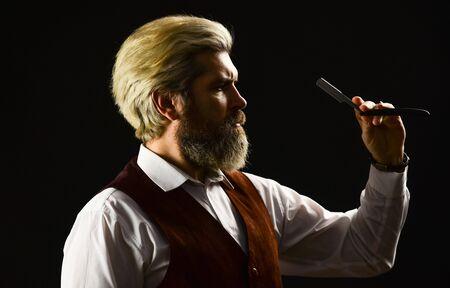 Barber scissors. barber shop. blond hairdresser or barber with scissors. Hipster Man Hairdresser. guy hairdresser cuts hair with scissors. male beauty salon. Make haircut look perfect.