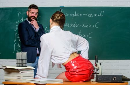 Everyone dreaming about such teacher. Lustful tutor. Experimenting with feelings. Attractive teacher latex skirt. Cheeky teacher. Impudent student. Flirting colleague. Girl sexy buttocks sit table