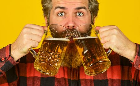 Brutal bearded male drinks beer from glass. Beer pub. Stylish bartender or barman in bar. recreation. Man hold glass of beer. hipster at bar counter. having fun watching football Stock fotó