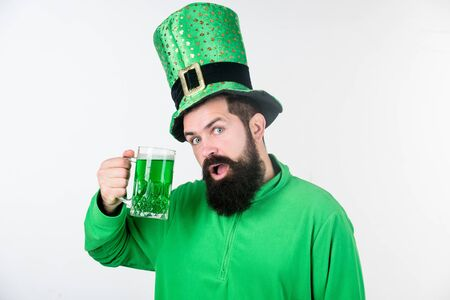 Here is to a long life and a merry one. Bearded man toasting to saint patrick. Irish man with beard drinking green beer. Hipster leprechaun holding beer mug. Celebrating saint patricks day in bar